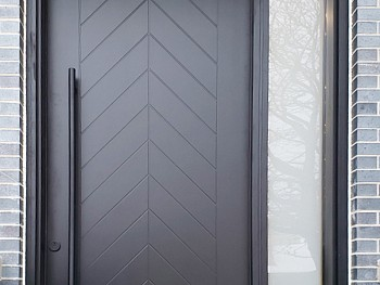 Modern 8 foot smooth skin Chevron door with sidelite and transom