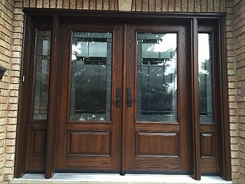 Exterior fibreglass door installation with glass detailing by FORHOMES Ltd.