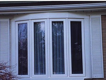 White bay windows with curtains instsalled by window and door company in FORHOMES Ltd.