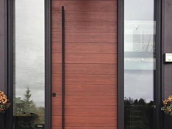 Modern 8 foot textured fiberglass door with horizontal grooves and derect set clear sidelites