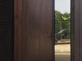 Pivot 8 foot door with vertical shadow grooves and clear sidelite and transom