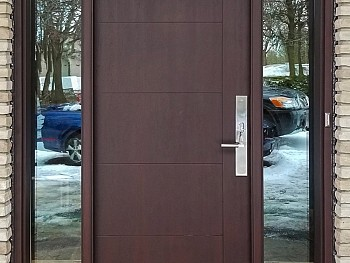 Modern 7 foot textured fiberglass door with shadow groovs and clear sidelites