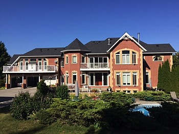 Large red brick estate with windows and doors from Toronto company.