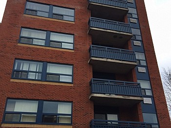 Tall apartment complex with multiple vinyl window installations in Toronto & Mississauga.