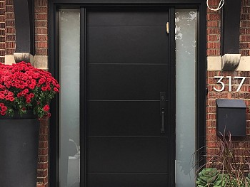Modern fiberglass door with wide shadow grooves and satin etch sidelites