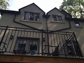 Iron balcony with custom window installation from FORHOMES Ltd. in Toronto.