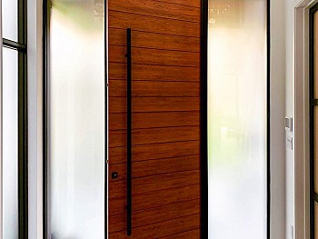 Modern 8 foot Oak panel with horizontal grooves and derect set satin etch sidelites - Inside view