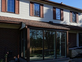 Contemporary Vinyl windows with bronze paint
