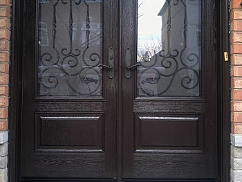 Double fiberglass door with dark chocolate stain and privacy glass/ wrought iron inserts