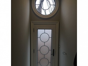 CUSTOM DOOR WITH CUSTOM SHAPED WINDOW