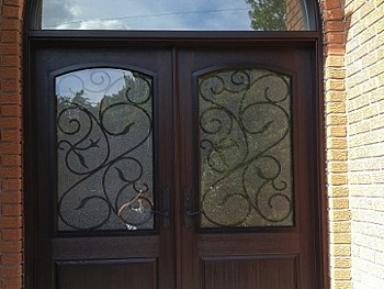 Fiberglass door with privacy glass and Wrought Iron design Exterior View Including massive transom