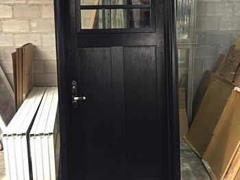 Fiberglass door with top panel cut out just out of production