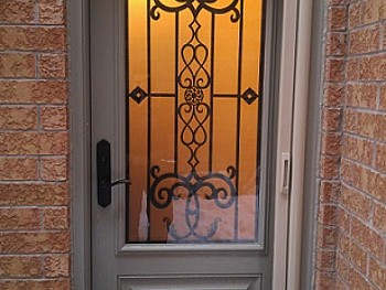 Fiberglass door with beautiful custom glass/ wrought iron insert
