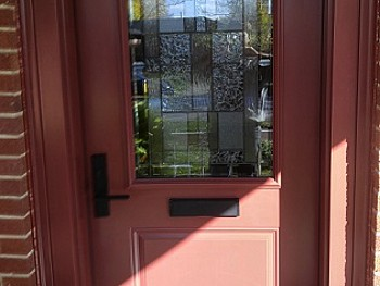 Custom salmon coloured steel door with 1/2 insert