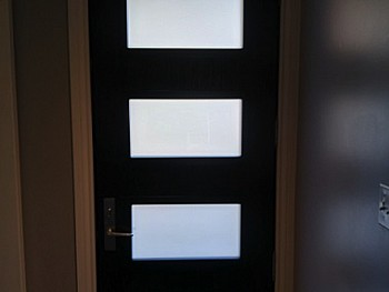 Dark fiberglass door with Quadruple inserts interior view