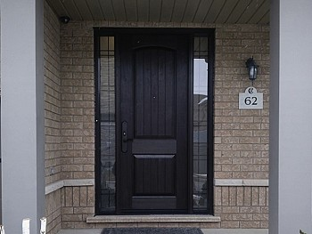Two sidelite fiberglass door with rustic engraved panel