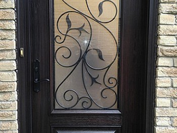 Fiberglass door with decorative/ privacy glass 3/4 insert including wrought iron