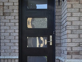 Dark fiberglass door with Quadruple inserts exterior view