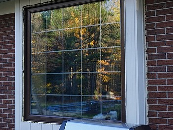 Vinyl windows with false shutters and interior SLDs