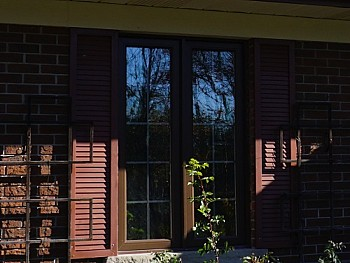 Contemporary windows with false shutters and grilles