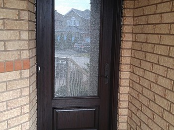 Fiberglass door with stylized 3/4 glass insert view from the exterior