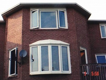 white exterior bow window and casement window Caledon