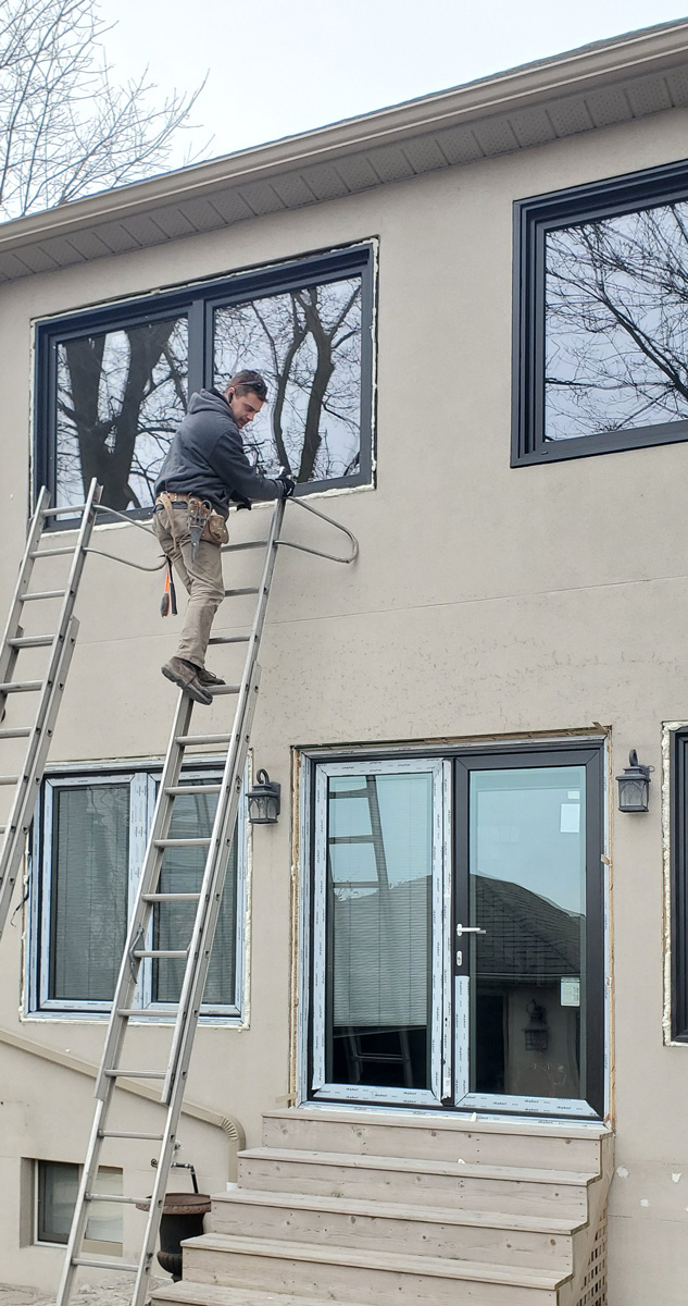 Forhomes installer on the ladder in Etobicoke